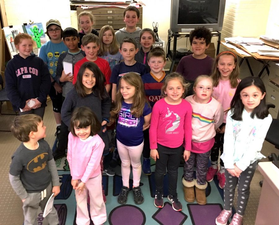 Student journalists working for the expanded and updated Lowell Times pose after their first day in the newsroom at Lowell Elementary School in Watertown, Mass., on April 4, 2019.